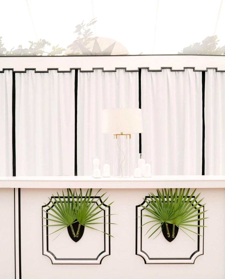modern wedding bar with white drapes and greenery