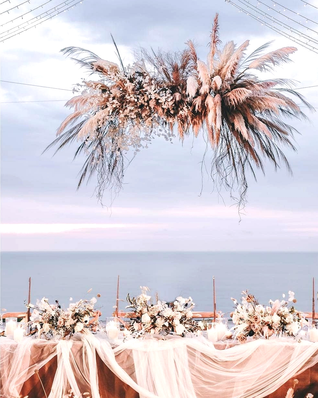 boho wedding table with white gauzy linen