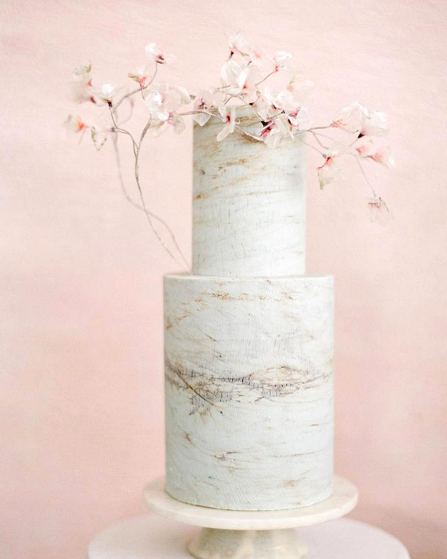 marbled wedding cake with Japanese sugar flower accent