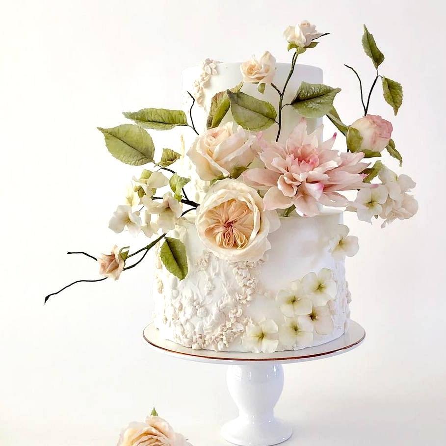 garden inspired wedding cake with pastel sugar flowers