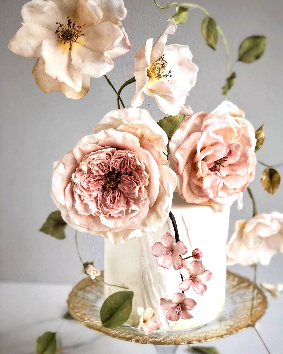 mini garden wedding cake with oversized sugar flowers
