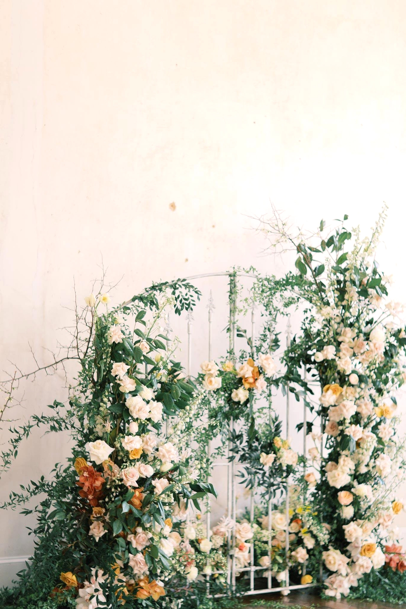 floral iron gate wedding backdrop
