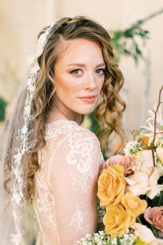 vintage lace wedding dress with a floral appliqué bridal veil