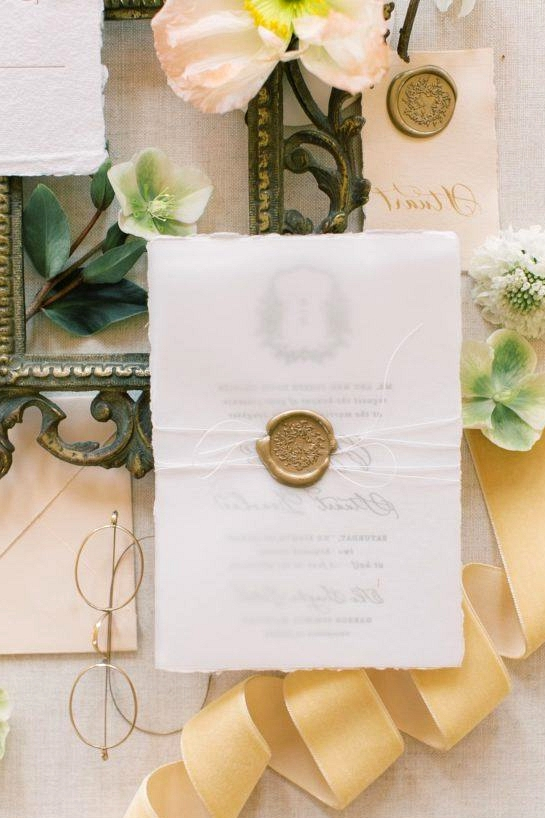 wedding paper goods with brass wax seal and white twine