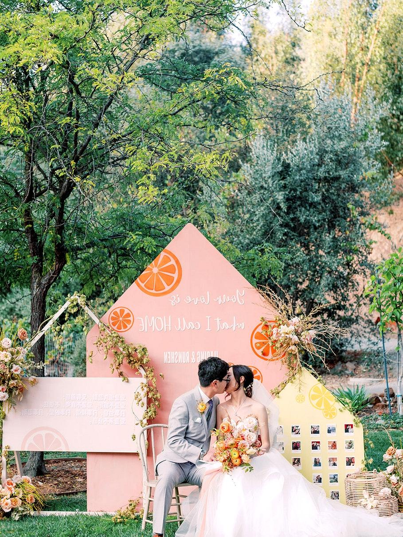 orange fruit wedding decor backdrop