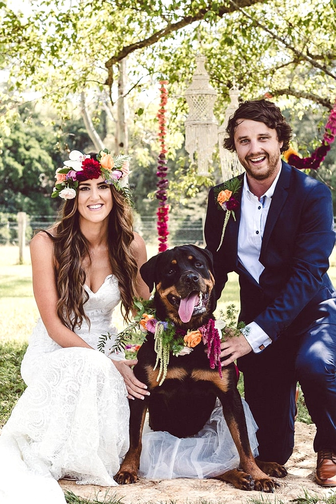 Bright tropical boho wedding bride and groom with dog wearing floral collar and tutu | Red Berry Photography