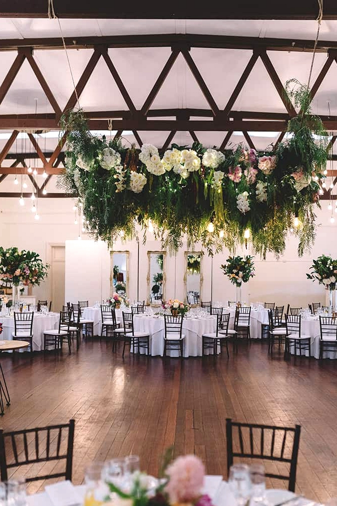 Romantic wedding reception in vintage dining room with floral dance floor canopy | Vanessa Norris Photography