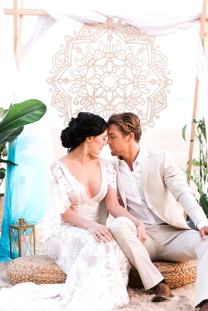 Boho beach wedding ceremony with aqua blue dip dyed fabric and laser cut mandala | Kaitlin Maree Photography