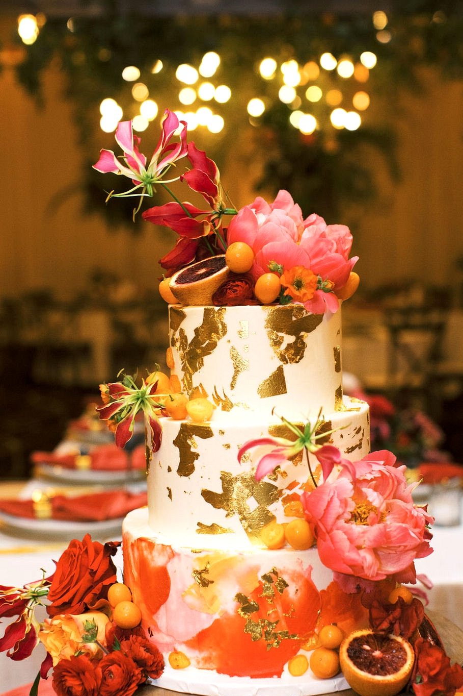coral charm peony and gold leaf wedding cake
