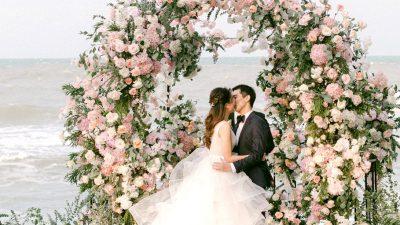 Lush Seaside Backyard Wedding ceremony with a Twinkle Lit Reception