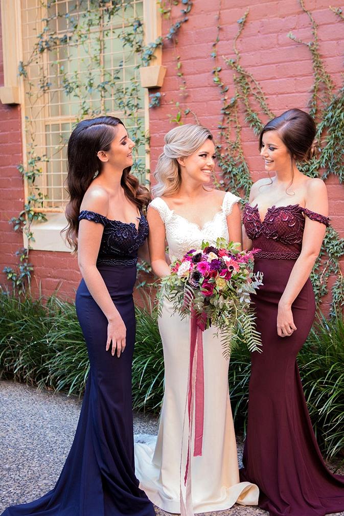 Elegant burgundy and navy off the shoulder bridesmaid dresses | Lola Images