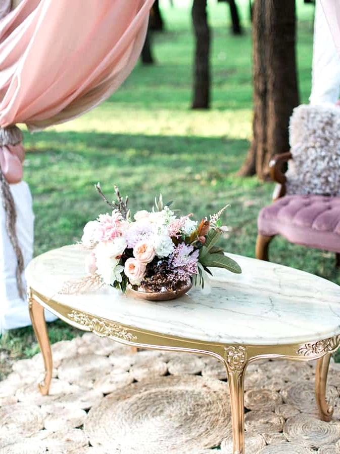 Gold and marble coffee table and pastel florals