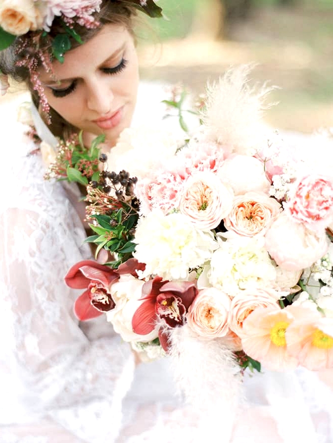 Pastel wedding bouquet with peonies, poppies, orchids and roses
