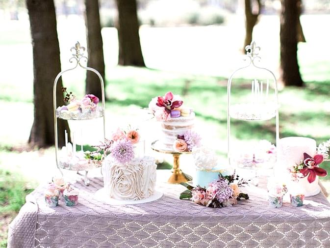 Pastel wedding cake and dessert display