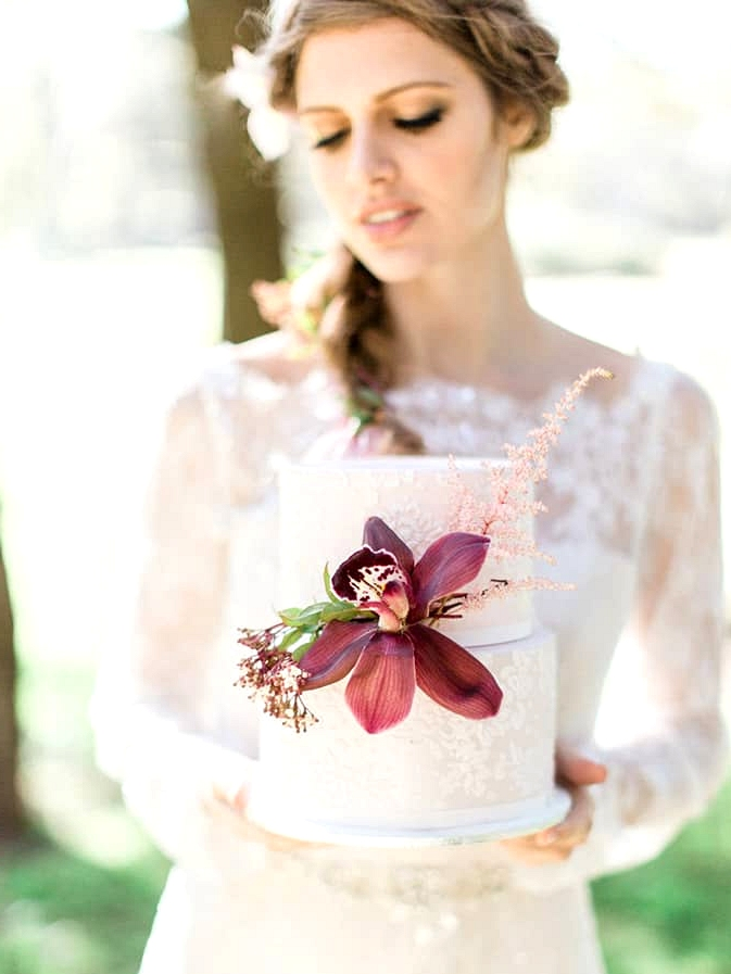 Elegant white wedding cake with orchid detail