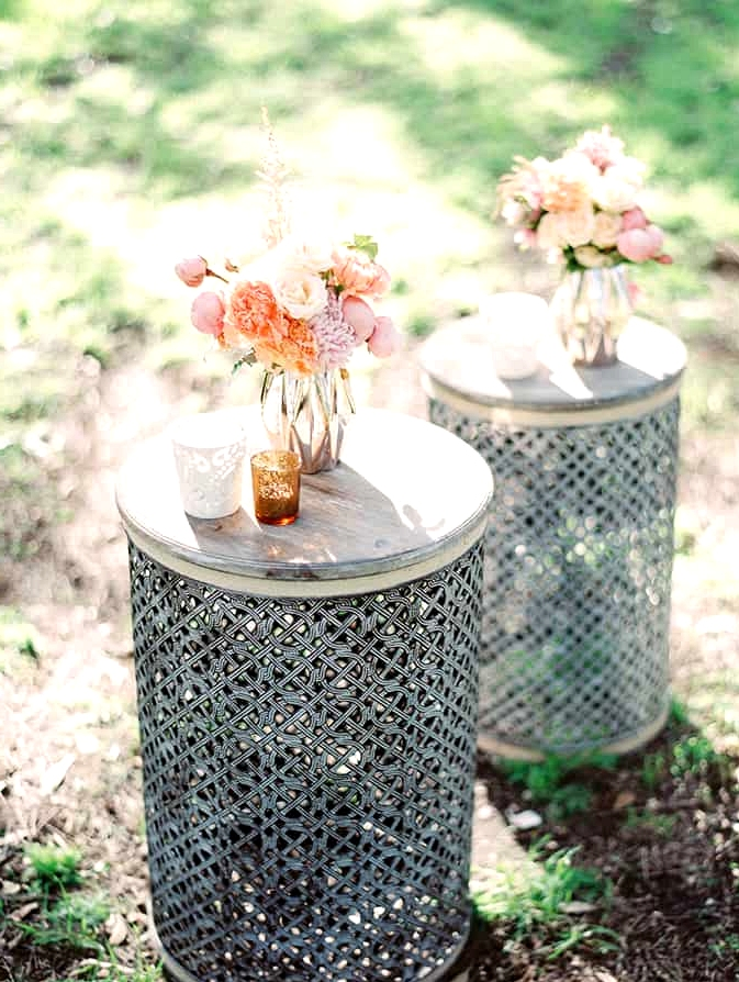 Wedding lounge tables with pastel florals and votives