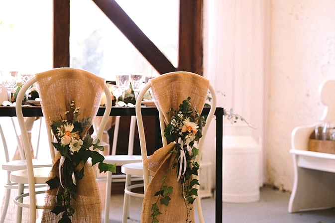 Relaxed-Vintage-Boho-Wedding-Inspiration-Reception-Chair-Back-Flowers