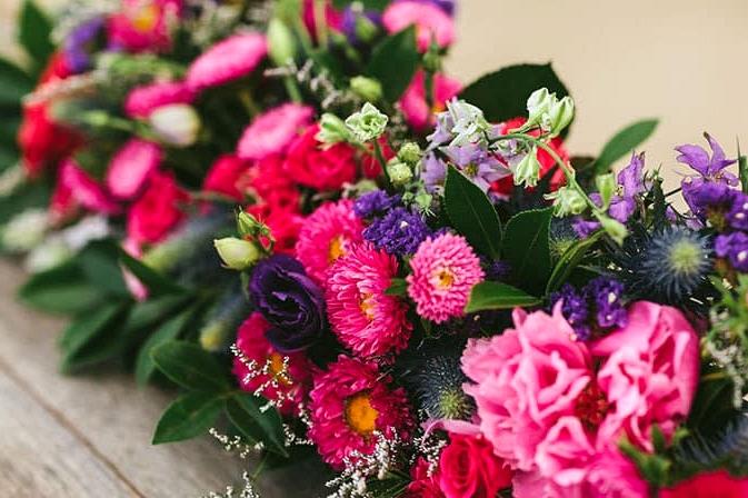 Bright flower table runner centrepiece