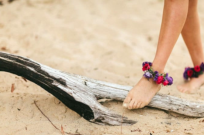 Bright flower anklets for beach wedding
