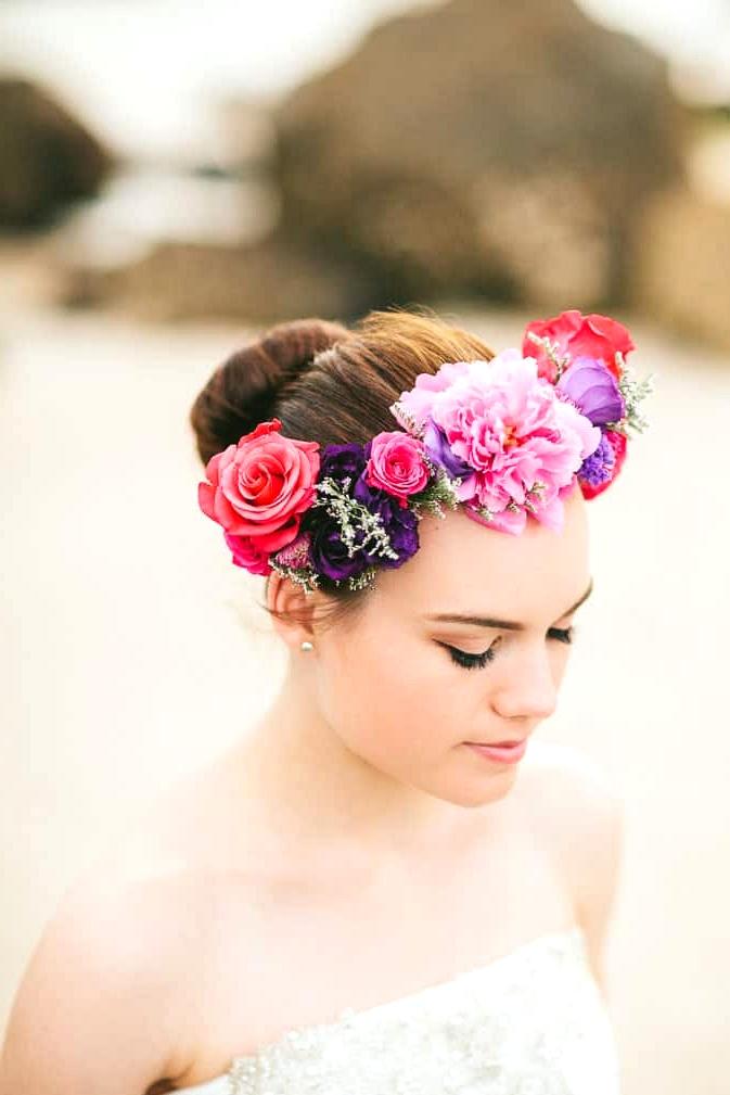 Elegant beach bride wearing bright flower crown