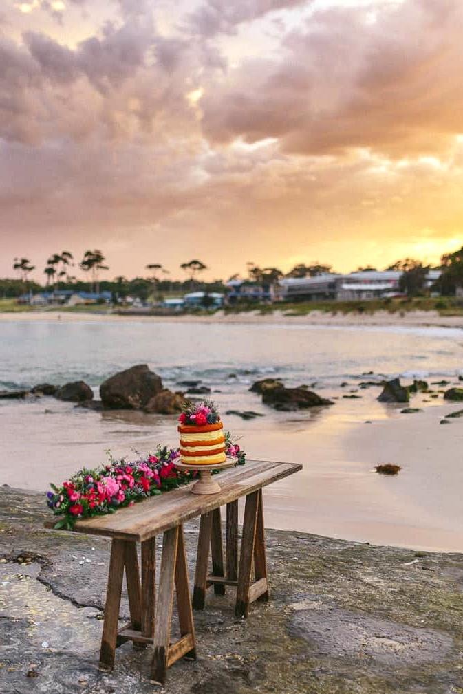 Beach wedding cake at sunset