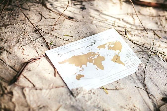 World map travel inspired wedding invitation