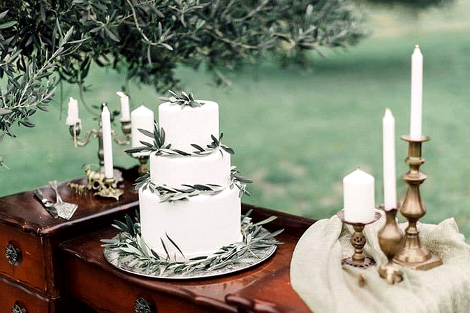Romantic-Bohemian-Wedding-Inspiration-Olive-Leaf-Cake-Table-Candles