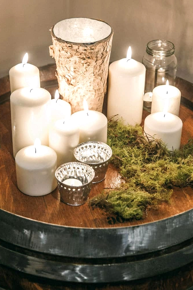 Wedding reception candle display on wine barrel