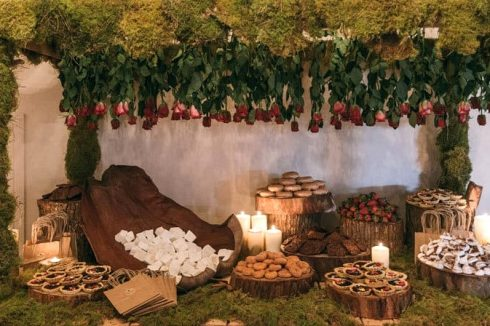 Woodland wedding reception dessert display table