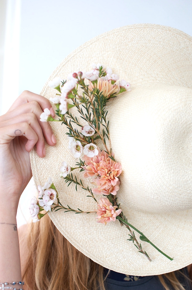 hat with fresh flowers
