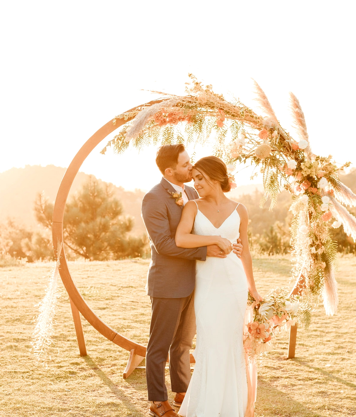wyatt gown by Lovers Society x Green Wedding Shoes with floral ceremony arch