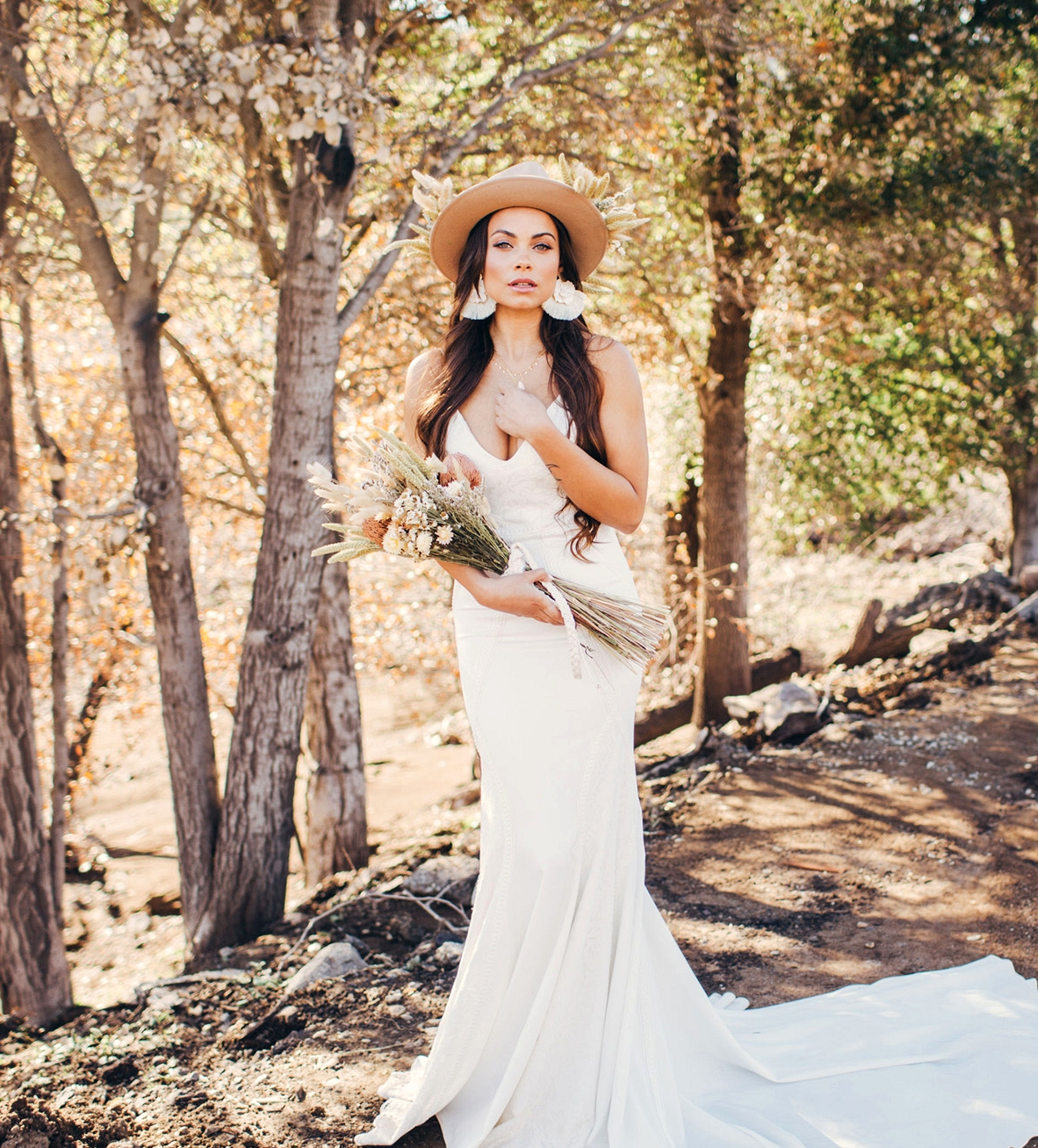 green wedding shoes x lovers society wyatt wedding dress with flower hat and dried flower bouquet
