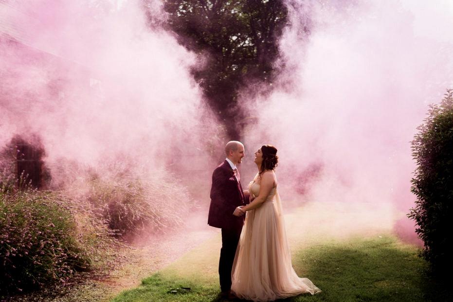 pink smoke bomb wedding photographs